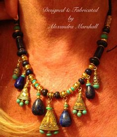 """Almost Finished. Myra stopped by my studio today to confirm the length she wanted my custom made interpretation  of a lapis and turquoise with gold washed brass components Tibetan necklace she will enjoy with the fabulous """"Tibetan"""" cuff she found in Neiman Marcus."""