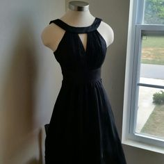 """HOST PICK  08/01/15..WHBM....STUNNING DRESS... EXCELLENT CONDITION.brand new with tags this dress is GORGEOUS. ... color black.. the detail on this dress is beautiful as shown up close on 2 pic...around neck and chest the detail is really nicely done..100 %polyester..has a zipper on back...this dress is gorgeous better in person... Top to bottom dress is ..37"""" long.. ......TAKING OFFERS.... White House Black Market Dresses"""