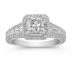 Shane Co. Princess Cut, Baguette, and Round Diamond Engagement Ring. This beautiful vintage inspired halo engagement ring features a beautiful princess cut diamond, at approximately 1.04 carats, four baguette diamonds at approximately .17 carat TW, and 226 round diamonds at approximately .68 carat TW. Set in quality 14 karat white gold, the total diamond weight is approximately 1.89 carats.