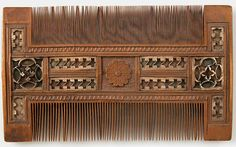 Comb Date: 15th–16th century Culture: French (?) Medium: Boxwood inlaid with bone, and decorated with red and green silk Dimensions: Overall: 3 7/8 x 6 1/2 x 3/8 in. (9.8 x 16.5 x 1 cm)