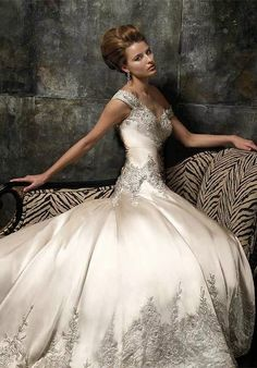 Magnificient details on silky wedding gown