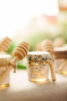 Honey By now you can probably guess what we're going to tell you, right? Buying in bulk and packaging in scrumptious little jars is a clear winner on the wedding favor routes you can take.