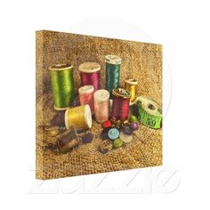Sewing Supplies Gallery Wrapped Canvas ~   This colorful wrapped canvas print displays the tools of the seamstress. Bright spools of thread in rainbow colors of green, red, pink, turquoise, yellow, gold, blue and orange stand beside a measuring tape, thimble, buttons and pins.