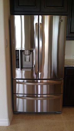 "Use ""Pledge"" to clean stainless steel appliances, works better than anything!"