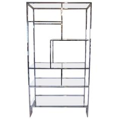 Milo Baughman Chrome and Glass Etagere | From a unique collection of antique and modern shelves at https://www.1stdibs.com/furniture/storage-case-pieces/shelves/