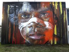 """Portrait of a young Aboriginal Boy on the side of a building that overlooks Newcastle Harbour, Australia Artwork by """"Adnate"""" 2013 Hit the Bricks Festival Newcastle Aboriginal Culture, Aboriginal Art, Aboriginal People, Graffiti Art, Urbane Kunst, Street Mural, Mural Art, Murals, Wall Art"""