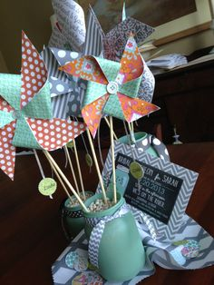 A different kind of centerpiece. Handmade pinwheels made from coordinating scrapbook papers to match the luncheon's theme and colors, painted mason jars and lots of beans. The guests' names were attached to the pinwheels and they got to take them home as favors. Fun!
