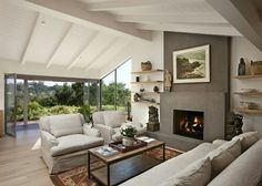 White vaulted painted ceiling and beams. Light floors. Plaster fireplace surround.