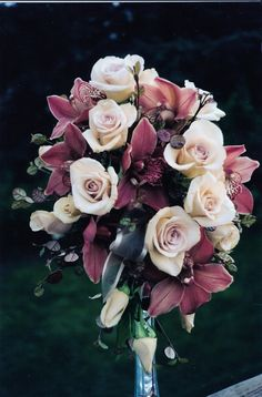 The Roses and orchids have an antique but elegant look in this bouquet by www.flowersandstuff.com