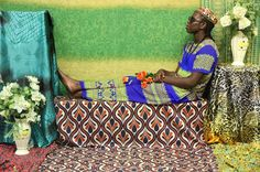 A Tribute to African Roots in Portraits  Atong Atem is a young photographer from South Sudan who lives and works in Australia. In front of her objective her fiends show their faces from Africa too. The scenery created somehow plays with the codes of kitsch the very standardized presentation in African photographers studios is modernized. The juxtaposition of fabrics and the mix of modern and traditionnel elements create an atmosphere slightly nostalgic.               #xemtvhay