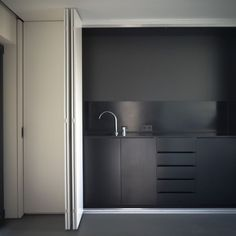 Minimal sober black kitchen. Interior