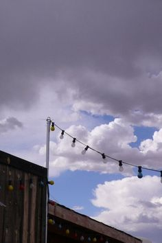 Rodeo Lights  and stormy sky, Galisteo, New Mexico © Helen Jones-Florio
