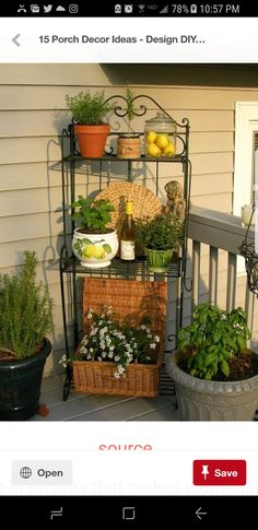 That's a great idea for the end porch wall - a baker's rack with potted flowers/plants and other pretties. (Upstairs Downstairs: Outdoor Baker's Rack ~ Three Ways)