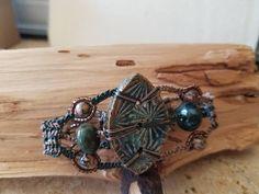 Macrame bracelet by Lisa Powell with Clayworks stoneware focal.