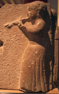 Woman in spiral-adorned belt  playing double pipes.   Osuna, after 200 bce.  ....archaeology & prehistoric