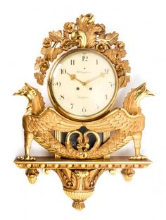 A Swedish Empire Style Giltwood Cartel Clock, Engstrom, : Lot 463