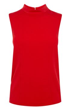 This simple top comes in the must have shape of the season with it's high neckline and sleeveless styling. The piece is finished on the reverse with pretty button fastenings down the centre. #autumncovered