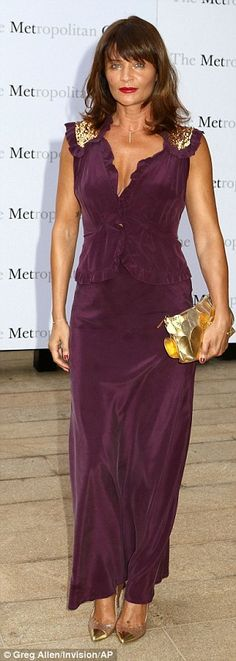 Helena Christensen, 46, displayed a deep golden tan in a wine gown with metallic gold accessories