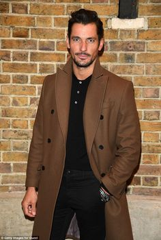 Back to black: He wore a black shirt with matching fitted trousers and brown boots to the bash