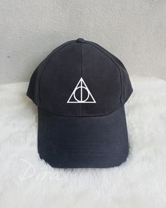 A Deathly Hallows baseball cap will be the perfect addition to your OOTD. | 25 Harry Potter Accessories That Are Actually Stylish