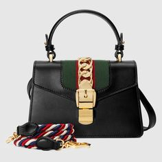 Shop the Sylvie leather mini bag by Gucci. The Sylvie mini bag in a top handle shape with nylon Web embedded under the fabric and decorated with a gold chain and buckle. Gucci Leather Bag, Small Leather Bag, Brown Leather Handbags, Leather Backpack, Black Leather, Gucci Shoulder Bag, Shoulder Handbags, Shoulder Bags, Gucci Sylvie