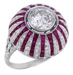 Art Deco 1.85ct Diamond Ruby Platinum Ring, This is an impressive platinum ring from the Art Deco period. The ring is centered with sparkling round cut diamond that weighs approximately 1.85ct. The center diamond is accentuated by lovely french calibre cut rubies that weigh approximately 2.70ct and sparkling round cut diamonds that weigh approximately 1.00ct
