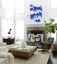Contemporary Modern Living Room: Large-scale art accented in a window-lit contemporary living room..