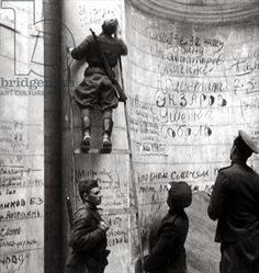 1945 - Soviet soldiers writing on the walls of the Reichstag, the Parliament of Third Reich from 1933 to 1945, in Berlin.