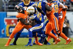Broncos vs. Chargers:   October 13, 2016  -  21-13, Chargers   -      San Diego Chargers running back Melvin Gordon #28 stiff arms Denver Broncos outside linebacker Shaquil Barrett #48 at Qualcomm Stadium, San Diego, CA October 13, 2016.