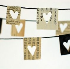 little paper hearts //yarn or some other type thin cord. Cut pieces from book/newspaper and fold over yarn/cord. Punch hearts into paper. This would be great as a garland for Valentine's day. Use other style punches for other holidays. Paper Heart Garland, Flag Garland, Pom Pom Garland, Paper Bunting, Diy Garland, Garland Ideas, Mini Bunting, Paper Garlands, Bunting Banner