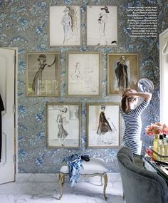 A delightful Miles Redd designed bathroom with gallery wall of  René Bouché fashion sketches. Wallpaper is Boussac's Tarantelle. Love that there's a window letting in natural light.