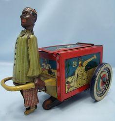 GREPPERT & KELCH G Rare German tinplate toy of a Madarin vendor pulling a cart. circa 1910.