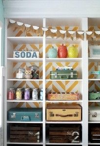 Contact paper backed bookshelf!  Easily changeable and so cute!!  herringbone-bookcase-decorate-with-vintage-goods-as-storage-600x875