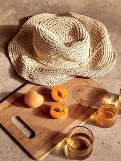 featuring fresh peach and the Mellow Mood straw hat.