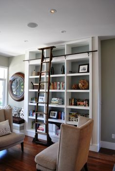 Have always liked ladders to reach the top!  Great idea for front porch library room.