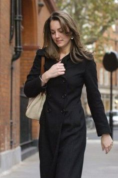 11/10/06 - Kate wore a black double breasted trench coat for the day's outing.