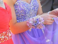 Prom Flowers - Wrist corsage for prom featuring lavender alstromeria and purple hyacinth blossoms.