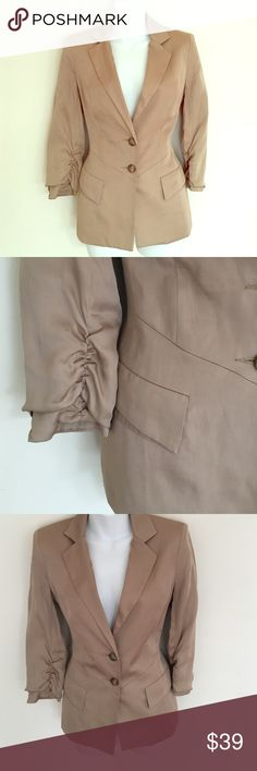 "Bebe fitted jacket Fitted tan color Bebe blazer.  Silky feel fabric 3 3/4 ruched sleeves  Measurements:  Shoulder to shoulder: 15 1/2"" Jacket length Back: 25"" Chest all around: 37"" Waist: 36"" Smoke and pet free home. bebe Jackets & Coats Blazers"