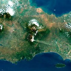 pictures of volcanoes erupting from space
