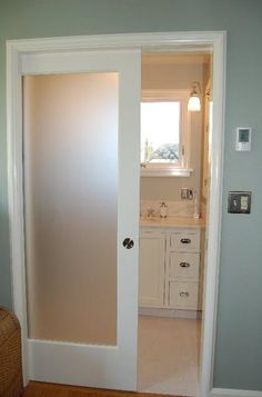 pocket door with frosted glass panel....keeps light flowing from one room to the next