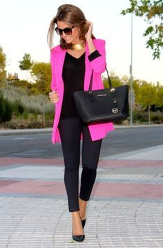 Pink long cardigan, black top, black ankle pants, black flats.