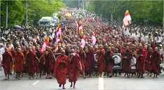 """A photo from the """"Saffron"""" Rebellion - From wikipedia: """"In 2007, a series of anti-government protests started in Burma (also known as Myanmar) on 15 August 2007. The immediate cause of the protests was mainly the unannounced decision of the ruling junta, the State Peace and Development Council, to remove fuel subsidies, which caused the price of diesel and petrol to suddenly rise as much as 66%, and the price of compressed natural gas for buses to increase fivefold in less than a week...."""""""