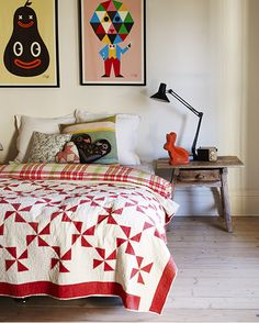 Pretty red and white  pinwheel quilt... love the heart pillows too!