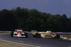 Alain Prost avoids a spinning Arrows in Hungary, en route to his second world championship in 1986.