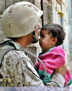 I love pictures like this. The media tries to convince the world that American soldiers are blood hungry killing machines, but really they are people just like us with the capacity to love and respect human life. Us Army Soldier, My Champion, Military Love, Military Quotes, Military Families, Military Gifts, Support Our Troops, We Are The World, American Pride