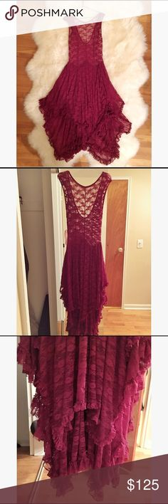 Free People Lace dress Gorgeous floor length burgundy transparent lace dress by Free People. Whimsical and bohemian.. This dress makes you want to swirl and frolic around. The plunging back adds a sexy element, while the lace softens the look. Throw a simple slip on under and wear it to a special occasion for a stunning and unique look. Never been worn. Perfect condition.. Hate to give this beauty up.. *AUTHENTIC FREE PEOPLE* Free People Dresses Maxi