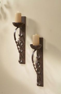 From any angle this pair of iron wall sconces finished in an antique gold will provide luxe lighting. Straight, solid wall mounts with twisted and rolled candle holders. Sold as a pair. Candle Wall Sconces, Wall Sconce Lighting, Bedside Lighting, Pillar Candle Holders, Pillar Candles, Candleholders, Sconces Living Room, Tuscan Decorating, Decorating Ideas