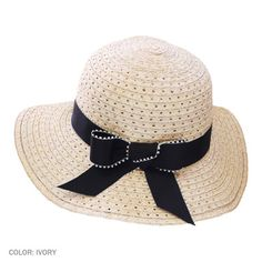 Stitch Rose Fancy Toyo Braid Floppy Hat (*Made to Order*). fancy toyo braid floppy in ivory with a black stitch. This hat is trimmed with a black grosgrain band which features an ivory looped edge.    Sizing Information:  Sizes - Small - 7 1/8, Medium - 7 1/4, Large - 7 1/2, X-Large - 7 5/8, XX-Large - 7 3/4    Made of:  100% toyo straw  Grosgrain Ribbon.  Lined  $88