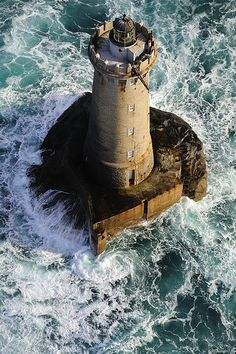The Phare de Four lighthouse, located 2km offshore of the wild Saint Laurent Peninsula in the town of Porspoder, France.
