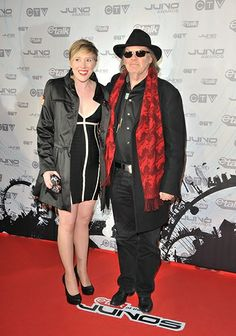 Neil Young poses with his daughter Amber at the 2011 Juno Awards in Toronto.